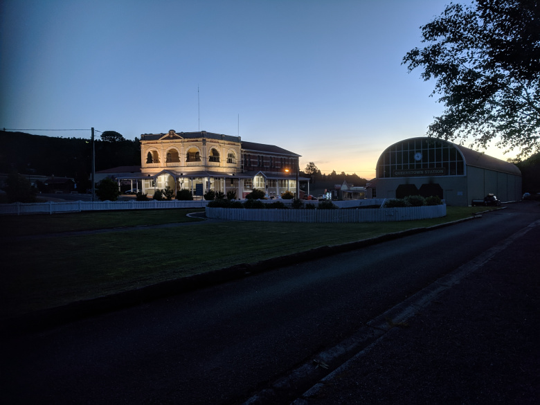 Queenstown Station and the Empire Hotel at dusk