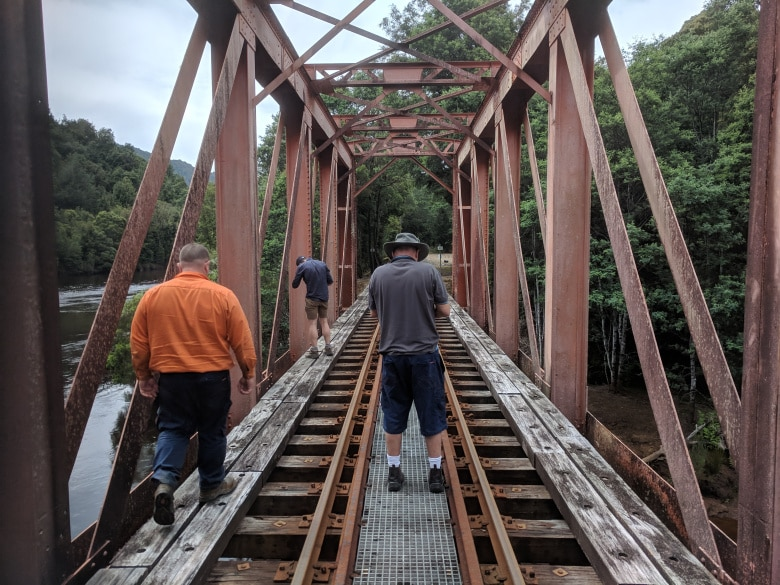 The crew films from the Iron Bridge over the King River