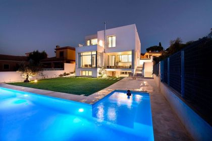 Spacious backyard and L shaped pool of luxury Spanish residence