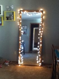 Hang Christmas lights up on your mirror in your room