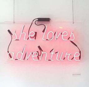 aesthetic quotes pink neon light quote adventure travel bright lights loves adventures visit words moments