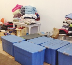 Donations to Warmth Warriors have to be sorted and organized before distribution. Photo by Kerri Banyas