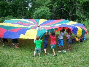 One of the most popular activities consists of several tennis balls and very large parachute fabric.