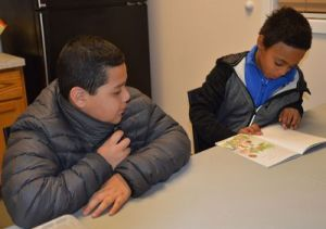 Fourth-grade student Kadyn Toris and fifth-grader Daniel Garcia read together.