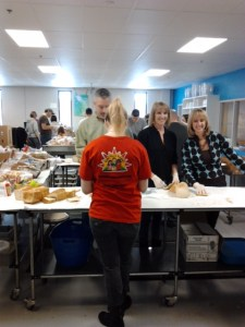 Volunteering for the Sunday Sandwich Makers involves her family and the families of her closest friends - 20 in all.