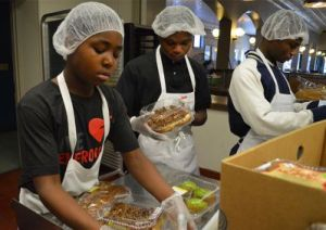 Students get food ready for Capitol Lunch at God's Kitchen.