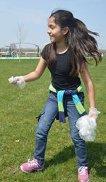 Jasmin Cruz hurries to clean up.