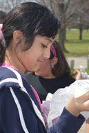 Parkview Elementary School fourth-grader passes out trash bags before beginning a cleanup of Lamar Park.