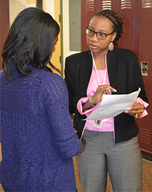 Aliya Armstrong offers advice to Kessia, a senior who has been homeless.