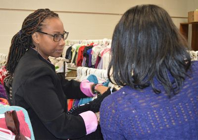 Aliya Armstrong organizes the district's Clothing Closet, with Kessia, a student who has faced homelessness. Kessia also volunteers in the clothes pantry.