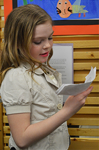"Third-grader Presley Harrison presents during ""Leaderville"""