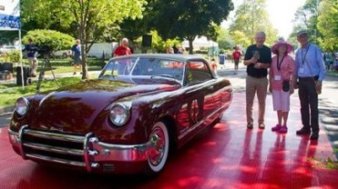 The 1950 Muntz Jet takes the stage with a rich merlot exterior and a sweet cream interior. Its estimated only 198 of these cars were produced.