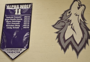 The first six Alpha Wolf 11s are honored on the gymnasium wall
