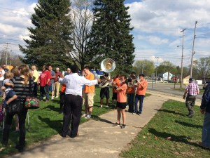 Members of the Kelloggsville High School band perform as people gather for the ground breaking ceremony at Kelloggsville High School.