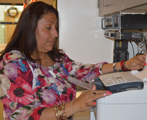 Lydia Hernandez, a mom interviewed by the human-centered design team, makes copies while volunteering at school