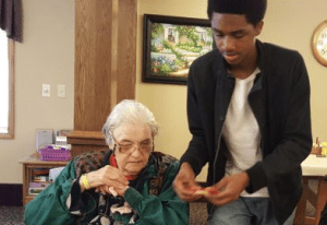 Kelloggsville freshman Miles Thomas-Mohammad sets up crafts for senior citizens