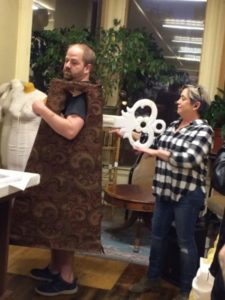 Costume and props designer Kathleen Johnson with actor Jason Morrison, who plays Cogsworth.