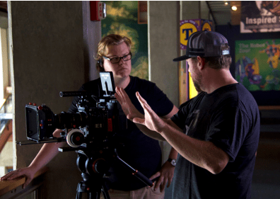Compass Alum, Kevin Sytsma (left), sets up the next shot with Director Harold Cronk (right).