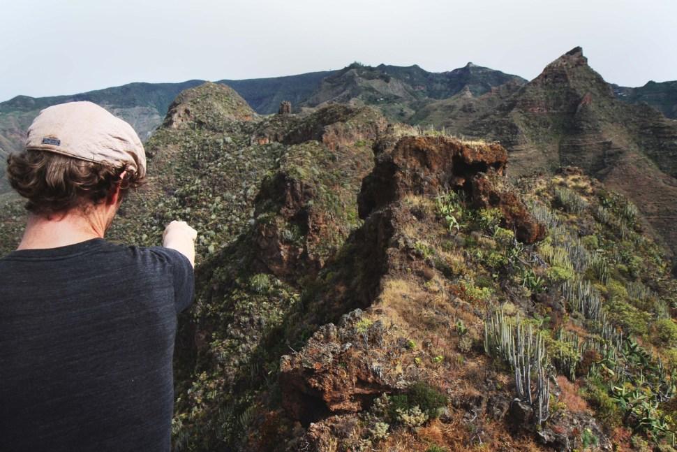 Weej pointing to ridge of three mountain peaks