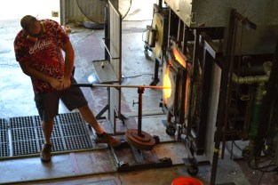 A live glass blowing demonstration. The artist is making a glass humpback whale