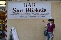 My mom in front of Bar San Michele