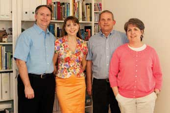 Jonathan Clark and his wife, Dr. Tatiana Baeva, pose with Chris and Robin Burgin.