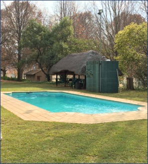 Berghaven pool with covered picnic area.