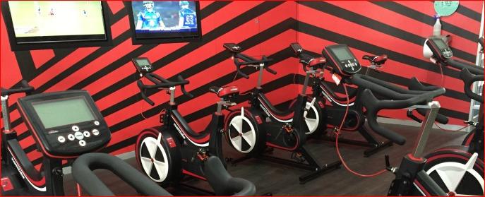Virgin Active Wattbike studio with TV's and fans.