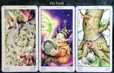 Fey Tarot: The Wheel, 2 of Pentacles, & 4 of Wands.