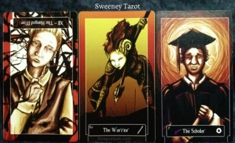Sweeney Tarot: The Hanged Man reversed, Knight of Wands, & Page of Coins.