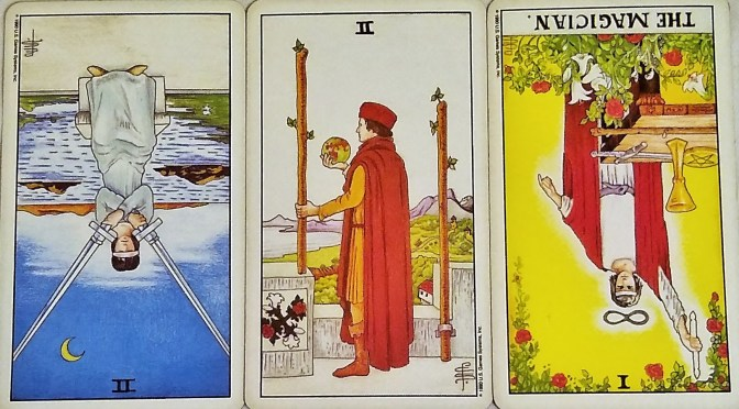 Universal Waite: 2 of Swords (reversed), 2 of Wands, & The Magician [I] (reversed).