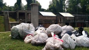 Most of the bags of trash and debris collected with Mt. Vernon Battery in the background