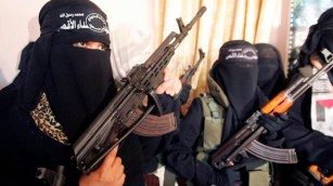 Female Palestinian suicide bombers attend a news conference in Gaza May 21, 2007. The bombers, members of the Al-Aqsa Martyrs Brigades, declared that they are ready to blow themselves up in attacks against the Israeli army if it attacks Gaza. REUTERS/Mohammed Salem (GAZA) - RTR1PXTW