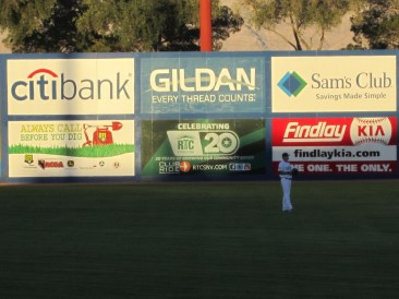 The outfield wall containing the NRCGA's 811 message.