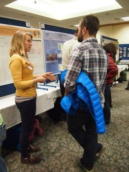 NREL graduate student Ann Raiho presenting her poster on managing white deer populations.