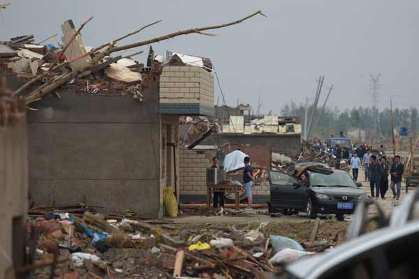 China mounts rescue efforts; tornado toll hits 98, hundreds more injured