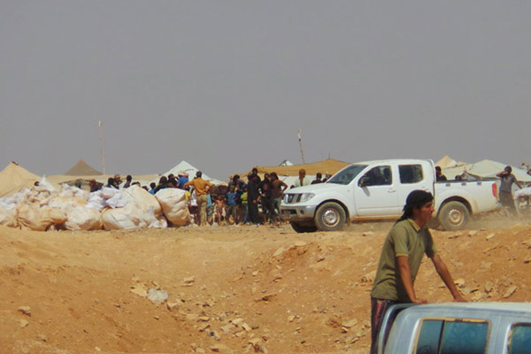 UN humanitarian chief sees first-hand harrowing conditions of refugees at Syria-Jordan border's berm