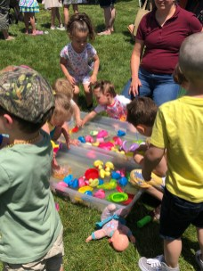 A group of kids enjoys free water games at the 2018 Family Fair.