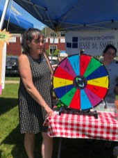 Librarian Lisa Stratton spins the wheel for guests.