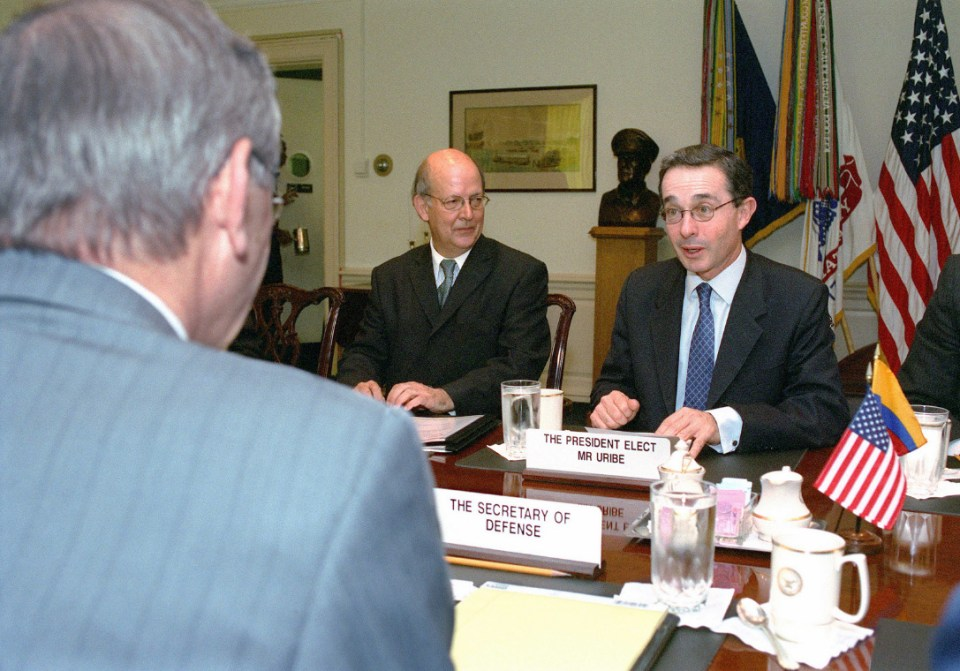 Álvaro Uribe (right) speaks during a Pentagon meeting with Donald H. Rumsfeld