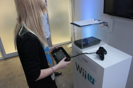 Katy getting to grips with the Wii U GamePad on ZombiU