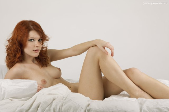 Red head In Bed with her Knees towards her head.jpg