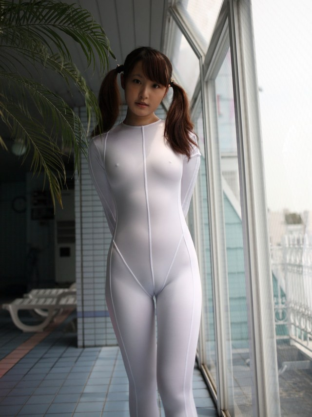 asian in see through white suit.jpg