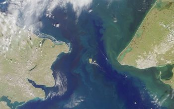 Figure 5. This satellite image shows the Bering Strait. Russia is on the left, Alaska is on the right. The Strait is about 85 kilometers across (miles). Warm water from the Pacific Ocean enters the Arctic Ocean via the Bering Strait. ||Credit: Wikimedia commons | High-resolution image