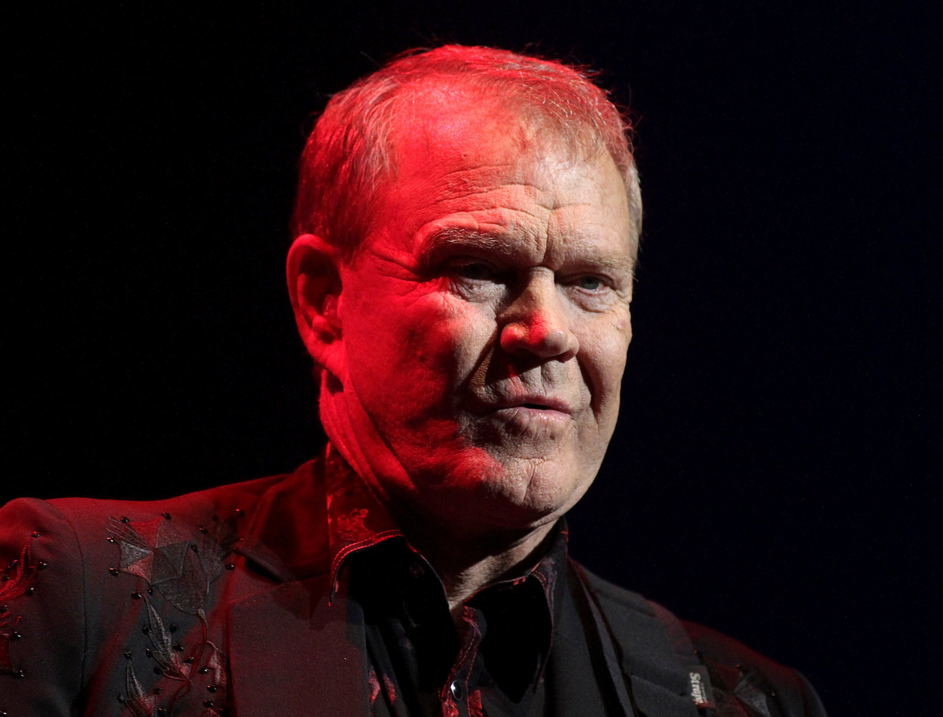FILE PHOTO: Singer Glen Campbell, currently on a farewell concert tour following his recent diagnosis with Alzheimer's disease, performs on stage at Club Nokia in Los Angeles, California October 6, 2011. REUTERS/Jonathan Alcorn/File Photo