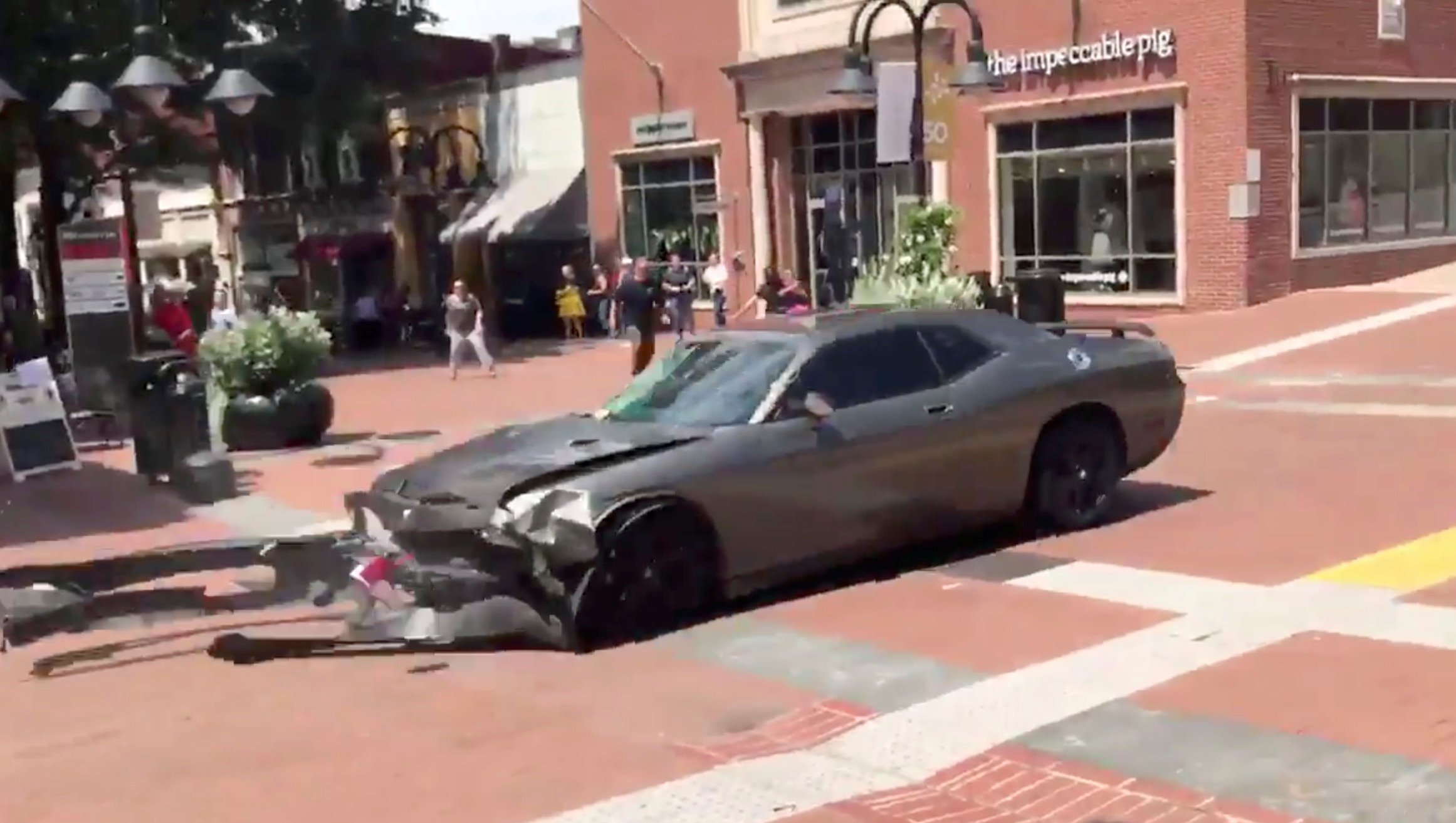 A vehicle is seen reversing after plowing into the crowd gathered on a street in Charlottesville, Virginia, U.S., after police broke up a clash between white nationalists and counter-protesters, August 12, 2017, in this still image from a video obtained from social media. Courtesy of Brennan Gilmore