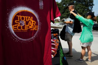 People shop for commemorative t-shirts in Carbondale, Illinois, U.S., August 20, 2017, one day before the total solar eclipse.