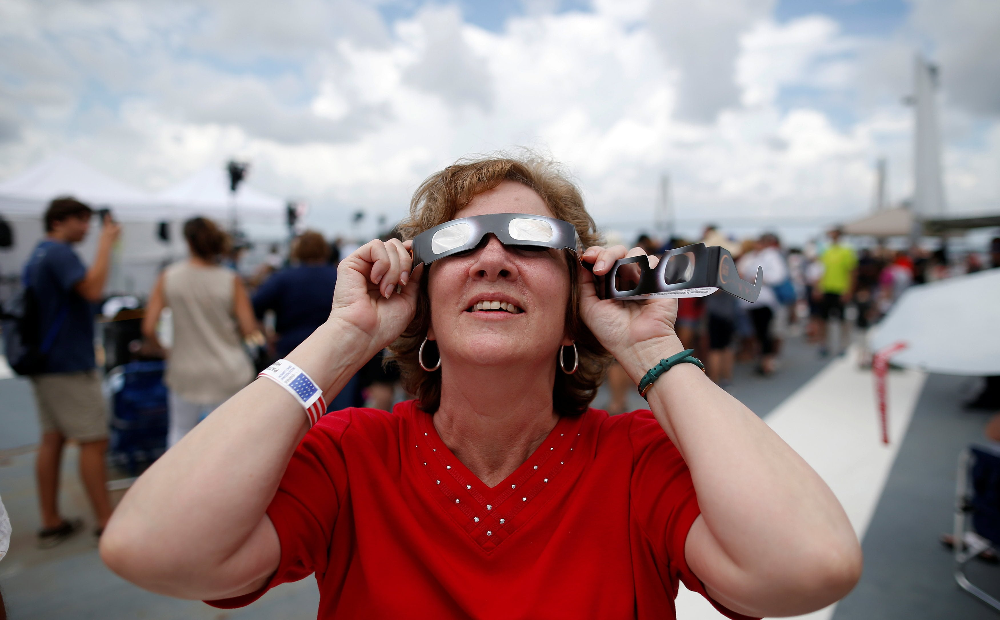Anita Hayes of Denver, North Carolina, checks out the position of the sun on the flight deck of the Naval museum ship U.S.S. Yorktown during the Great American Eclipse in Mount Pleasant