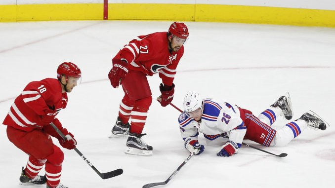 8e8d2afe3 New York Rangers left wing Jimmy Vesey (26) hits the ice against Carolina  Hurricanes defenseman Justin Faulk (27) in the second period of the NHL  home ...
