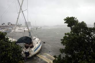 Boats are seen at a marina in South Beach as Hurricane Irma arrives at south Florida, in Miami Beach, Florida, U.S. September 10, 2017. REUTERS/Carlos Barria